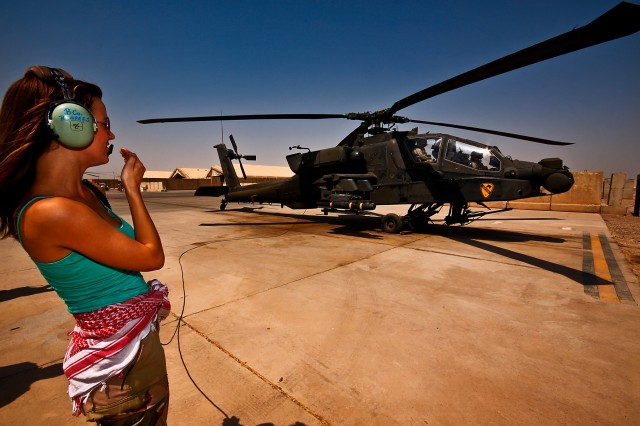 CAMP TAJI, Iraq-As AH-64D Apache attack helicopter pilots from 1st Battalion, 227th Aviation Regiment, 1st Air Cavalry Brigade, 1st Cavalry Division, Multi-National Division - Baghdad, prepare for a mission, Lisa Jay, an actress, wishes the pilots good luck over the internal communications system, Camp Taji, Iraq, Sept. 5. Jay, along with psychiatric specialist Dr. Robert Irvin, accompanied Emmy Award winning actor Joe Pantoliano on his 'Stomp the Stigma' tour where his goal was to educate Soldiers on mental illness and to make them more comfortable about getting help if necessary.
