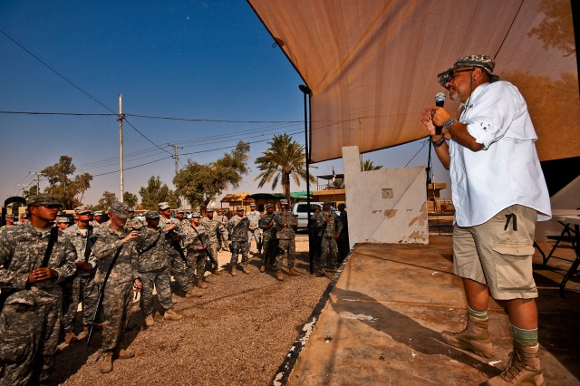 CAMP TAJI, Iraq-Soldiers of 4th Battalion, 227th Aviation Regiment, 1st Air Cavalry Brigade, 1st Cavalry Division, Multi-National Division - Baghdad, attend a speech by actor Joe Pantoliano (right) about mental illness. The presentation was part of the Emmy Award winning actor's 'Stomp the Stigma' tour, Camp Taji, Iraq, Sept. 5.