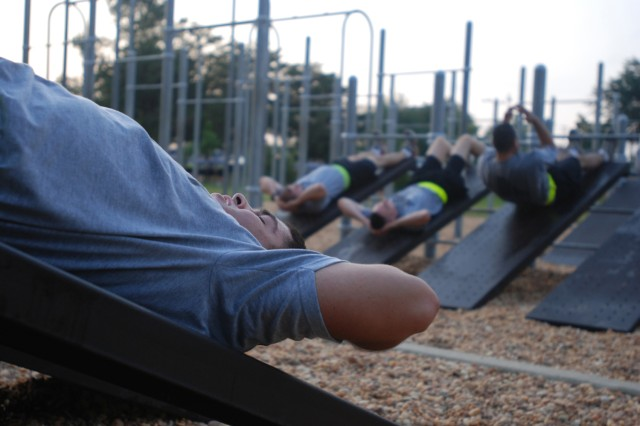 A Paratrooper with the 2nd Brigade Combat Team, 82nd Airborne Division takes a breath between elevated situps during morning Physical Training at Fort Bragg, N.C. Sep. 10.