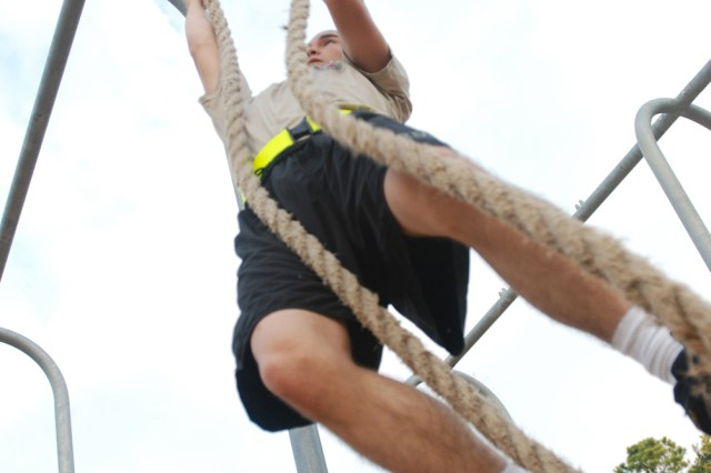 A Paratrooper with the 2nd Brigade Combat Team, 82nd Airborne Division climbs two ropes without using his feet during morning Physical Training at Fort Bragg, N.C. Sep. 10.