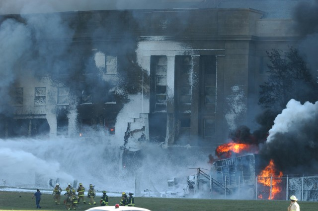 The Pentagon in flames moments after a hijacked jetliner crashed into the building at approximately 9:37 a.m. on Sept. 11, 2001.