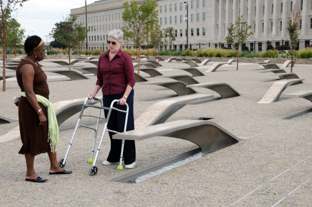 Mary Lou Bradley and Aline V. Tyler, both Department of the Army civilians with Army G-1, spent the latter portion of their lunch hour at the Pentagon Memorial, sitting on and walking amongst the 184 granite and stainless steel benches that represent the victims of the attack on the Pentagon.  The memorial was dedicated Sept. 11, 2008.