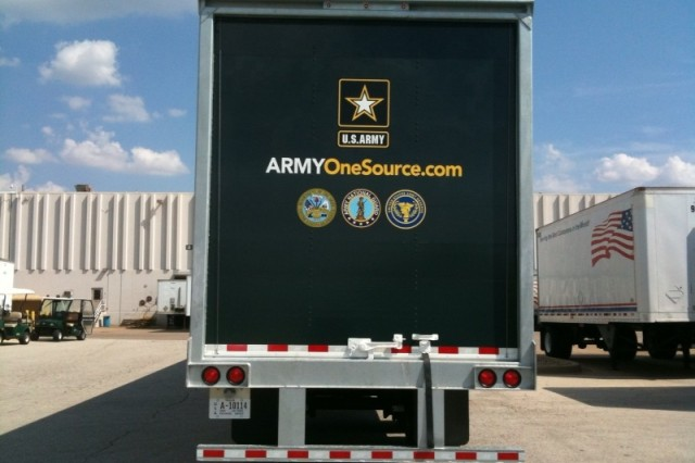 """The """"Army One Source"""" Web site is painted on the rear door of an 18-wheeler which will soon be delivering supplies to Army and Air Force Exchange Service sites."""