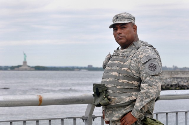 """Spc. Armando Chadilliquen of the New York National Guard is seen in front of the Statue of Liberty on Aug. 27, 2009, during a break from his duties with Joint Task Force Empire Shield, which has been continuously providing military support to civilian authorities since the terrorist attacks of Sept. 11, 2001. Chadilliquen still remembers his first formation immediately after the Sept. 11 attacks. """"Our captain asked us if there was a chance that [we were] going to war, if there were any volunteers, and we all raised our hands."""""""