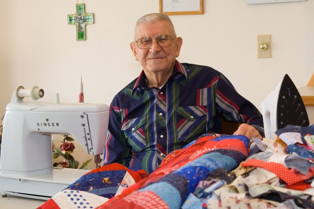 World War II veteran and former prisoner of war Al Lind, 91, works at his sewing machine to produce a quilt for a wounded warrior at his home in Quincy, Wash. So far, Lind has sewn and donated over 400 quilt tops through the Quilts of Valor Foundation.