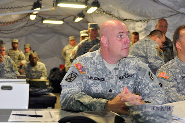 Lt. Col. Greg Dreisbach, commander of Joint Task Force Empire Shield, is briefed on task force activities in New York on Aug. 25, 2009. The New York National Guard's JTF Empire Shield has been continuously providing military support to civilian authorities since the terrorist attacks of Sept. 11, 2001.