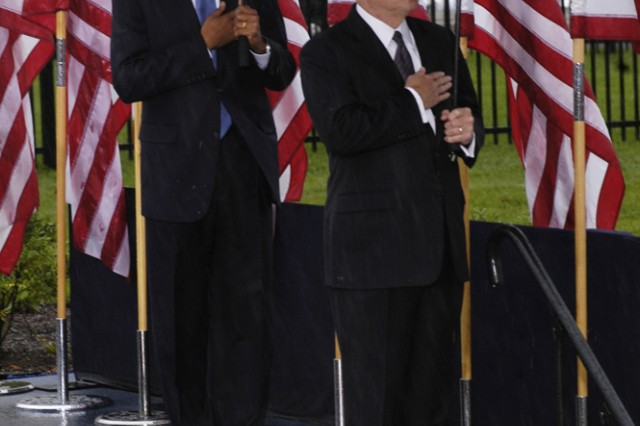President Barack Obama and Secretary of Defense Robert Gates hold their hands over their hearts as the U.S. Army Brass Quintet plays the National Anthem at the 9/11 Memorial ceremony at the Pentagon on Sept. 11, 2009.