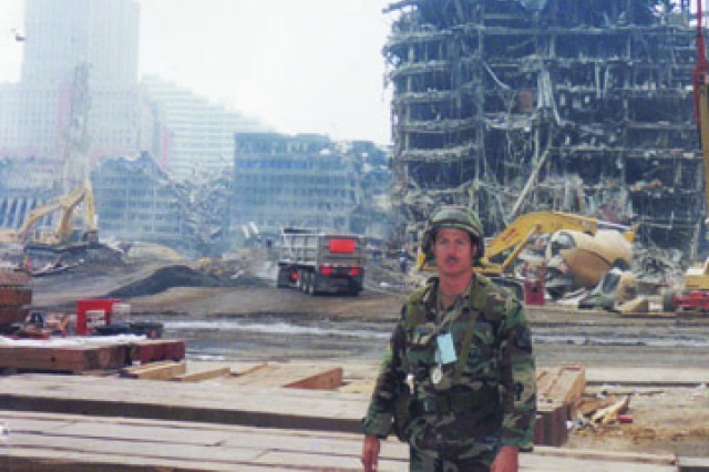 Paul Whelan stands before the rubble at Ground Zero several weeks after Sept. 11, 2001. Whelan spent several months at the site guarding the perimeter. No television shot, he says, could ever convey the vastness of the tragedy.