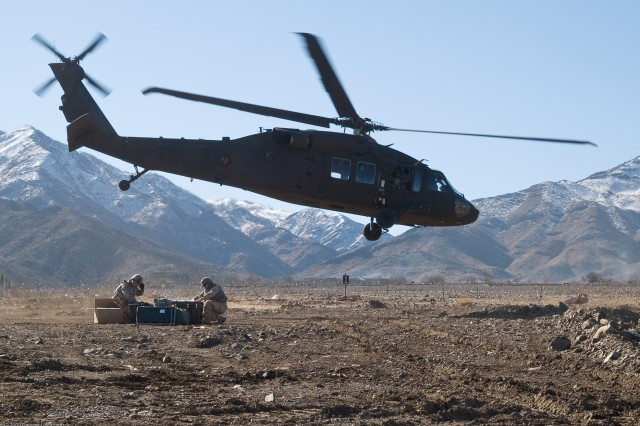 Due to the difficult terrain and unimproved roads in Afghanistan, the delivery operation relied almost exclusively on aerial transportation. Members of the ITAS Far Target Locator Fielding Team are dropped at one of the 14 fielding locations.