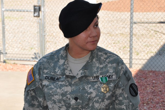 Spc. Ramona Dunlap watches as Brig. Gen. Walker speaks.