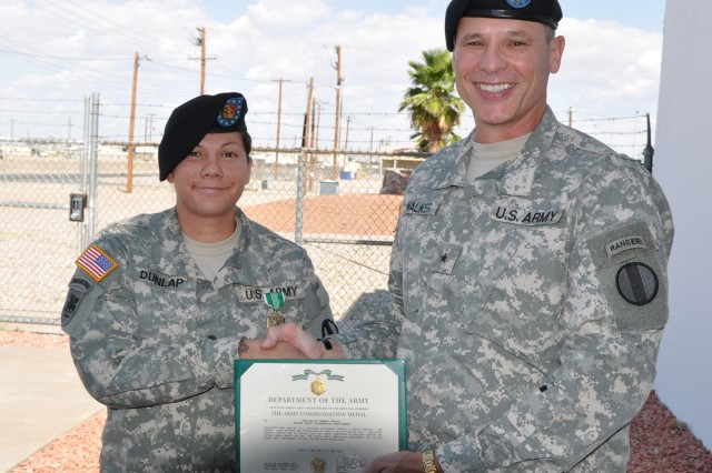 Brig. Gen. Keith Walker awards Spc. Ramona Dunlap for saving a fellow soldier's life.