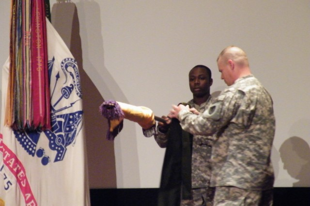 Sgt. Maj. William L. Kaundart, senior enlisted advisor to the commanding general, and Sgt. Jonathan Henry uncased the U.S. Army Security Assistance Command's colors at Redstone Arsenal for the very first time during the assumption of command ceremony at the Bob Jones Auditorium Sept. 11, 10 a.m.