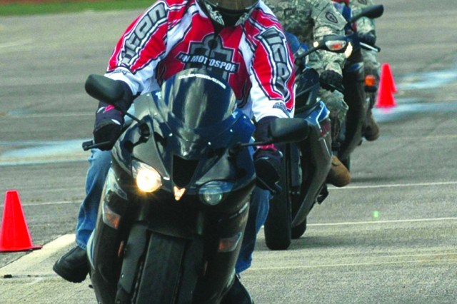 <b>Equipping riders with needed skills.</b>Service members prepare to maneuver a curve on a road course designed to build their confidence in turning techniques during the first U.S. Army Garrison-Hawaii sponsored advanced motorcycle safety course, held at Wheeler Army Airfield, Aug. 18.
