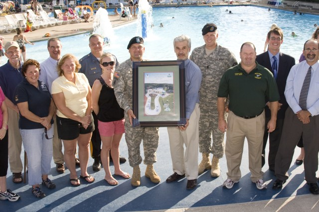 PICATINNY ARSENAL, N.J. - Lt. Col. John P. Stack, Picatinny's Garrison Commander (center in uniform) presents Mayor Louis S. Sceusi of Rockaway Township with a framed photo of the Picatinny Frog Falls Aquatic Park during its 10-year anniversary celebration here Aug. 24.
