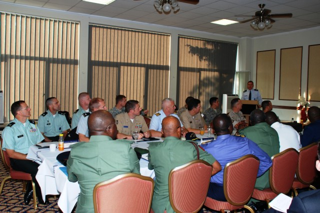 Participants of a Theater Security Cooperation planning meeting listen to Lt. Col. Hap Harlow, deputy division chief for West and Central Africa, as he provides an overview on U.S. Africa Command, Sept. 10, 2009, at Patch Barracks in Stuttgart, Germany. A delegation of six Nigerian senior flag officers responsible for military training, along with Country Team members from the U.S. Embassy in Abuja, traveled to Stuttgart to assist in planning the agenda for U.S.-Nigerian cooperation events for fiscal year 2010-2012.