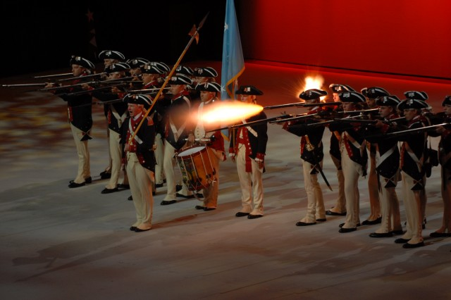 """Members of the 3rd U.S. Infantry perform the """"Spirit of America"""" historical pageant at the George Mason Patriot Center."""