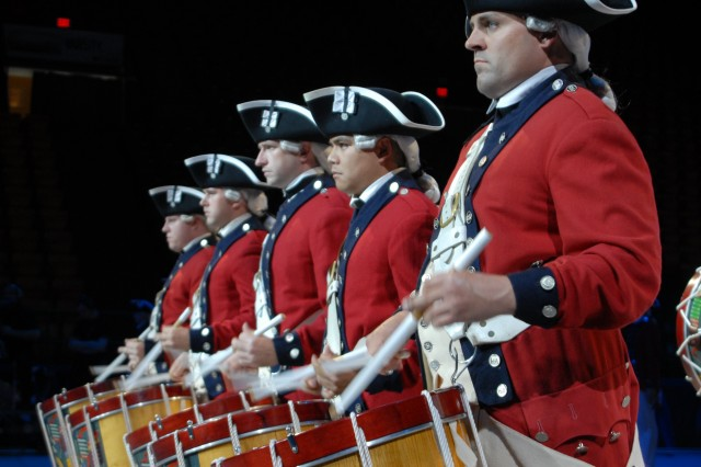 "Members of the 3rd U.S. Infantry perform the ""Spirit of America"" historical pageant at the George Mason Patriot Center."
