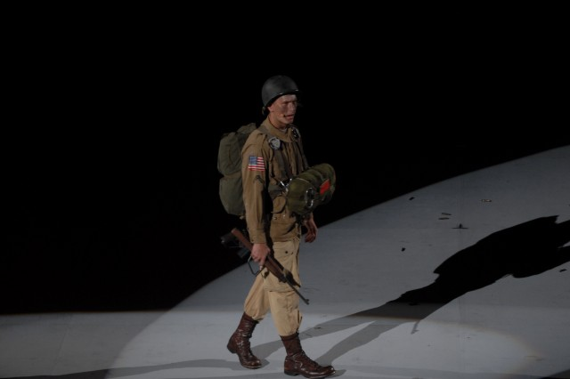 """A member of the 3rd U.S. Infantry performs the """"Spirit of America"""" historical pageant at the George Mason Patriot Center."""