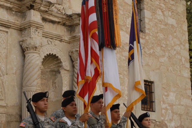 A color guard from the 321st Civil Affairs Brigade prepares to have the unit's colors passed along to its new commander, Col. Kenneth Moore, during a change of command ceremony outside the Alamo in downtown San Antonio. The ceremony drew crowds of onlookers and inspired Texan pride in the unit's Soldiers. The 321st is part of the U.S. Army Civil Affairs.