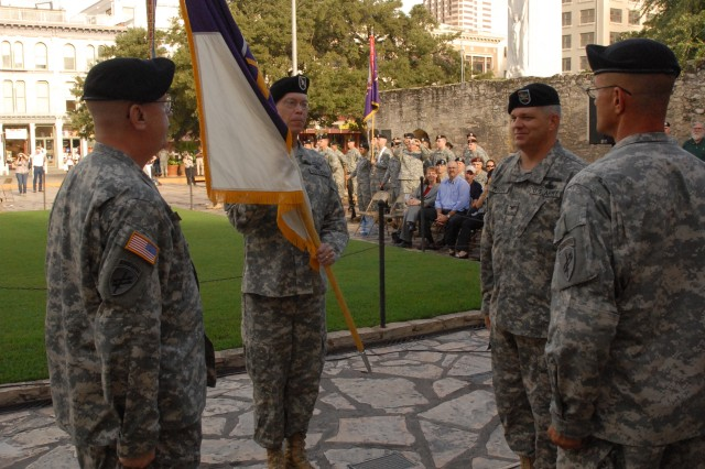Brig. Gen. Mark Hendrix, commanding general of the 350th Civil Affairs Command in Pensacola, Fla., holds the brigade colors of San Antonio's 321st Civil Affairs Brigade during the 321's change of command ceremony, Sept. 13, outside the Alamo in downtown San Antonio. Hendrix passed the colors from Col. Michael Finn, outgoing commander, to Col. Kenneth Moore, the 321's incoming commander, as Soldiers, family members, special guests and San Antonio tourists looked on. Finn, who filled in as the unit's acting commander for several months, returned to his position as the 321's deputy commander upon passing the brigade colors over to Col. Kenneth Moore, the unit's new full-time commander.