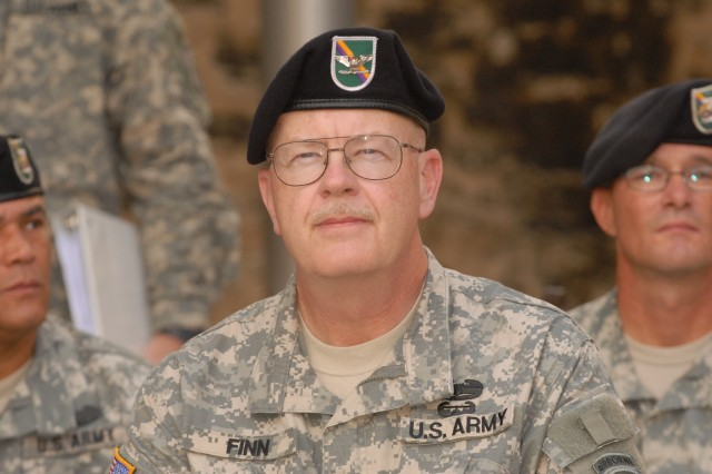 Col. Michael Finn, outgoing commander of the 321st Civil Affairs Brigade in San Antonio, sits with the unit's command group during a change of command ceremony, Sept. 13, outside the Alamo in downtown San Antonio. Finn, who has served as the brigade's acting commander for several months, is returning to the position of the unit's deputy commander to make room for full-time commander Col. Kenneth Moore, who assumed command during the ceremony. Finn, an Army Reserve Soldier with a civilian career working on Fort Sam Houston, is a Civil Affairs officer who deployed to Iraq in 2004 and will deploy again in 2010 to Afghanistan with the 321st.