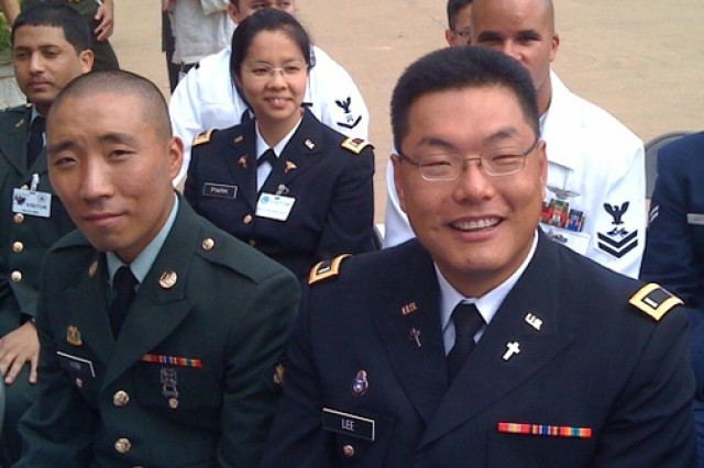 Chaplain (1st Lt.) YoHan Lee, right front, a recent Chaplain Basic Office Leader Course graduate, became a U.S. citizen during a Pentagon ceremony, Sept. 10. Lee and 30 other foreign-born U.S. military members, from 20 different nations, were naturalized.