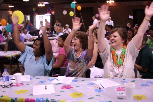 The Karaoke Idol judges, (from left) Karen Smith, Kathy Campbell, and Darcie Grindrod, really get into the competition, during USASMDC/ARSTRAT's organizational day at the Rustic Lodge on Redstone Arsenal, Ala., Sept. 10.