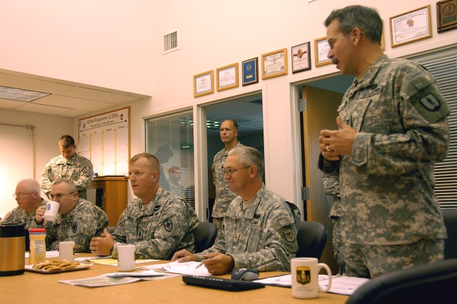 Col. Kenneth Koon, right, of the Wisconsin Army National Guard briefs senior artillery officers and non-commissioned officers Aug. 29 regarding the Wisconsin Regional Training Institute at Fort McCoy. Also pictured are, left to right: Brig. Gen. Ross Ridge, commandant at the U.S. Field Artillery School at Fort Sill, Okla.; Command Sgt. Major Daniel Willey of the U.S. Field Artillery School; Brig. Gen. Mark Anderson, deputy commanding general - Army National Guard at the U.S. Field Artillery School, and also Wisconsin's assistant adjutant general for Army. The visit - the first by an active component school commandant to a National Guard regional training center - was intended to give Ridge and his cadre a better understanding of the capabilities and resources provided at the RTI.