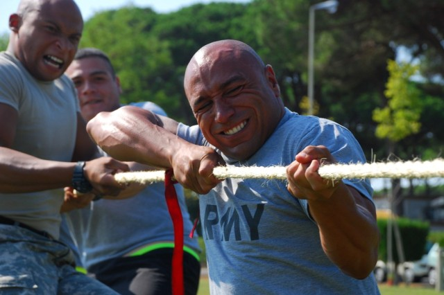 Sgt. 1st Class Mark Lindsey (right) 3/405th AFSB and Spc. Trey Harvey (left) AFN Livorno throw all of their muscle into the tug of war competition finals to secure first place over Team Italy.