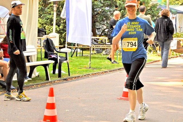Judith RodriguezVera, a German employee with the U.S. Army Garrison Wiesbaden, runs laps with the USAG Wiesbaden team during the 25-hour run.