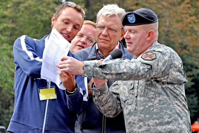 Col. Jeffrey Dill (right), U.S. Army Garrison Wiesbaden commander and a member of the USAG Wiesbaden running team, join Wiesbaden officials in announcing the winners at the city's 25-hour charity run.