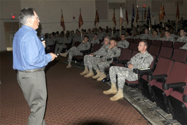"""Retired Army Col. Ramon A. Nadal (left) addresses senior leaders of the 7th Sustainment Brigade during an Officer Professional Development engagement held at Jacobs Theater Friday. The former 1st Cavalry Division officer was asked to speak about leadership during combat with senior leaders of the 7th Sust. Bde. Nadal is well known for serving in Vietnam alongside retired Army Lt. Gen. Harold Gregory """"Hal"""" Moore Jr., author of the book """"We Were Soldiers Once... and Young."""""""