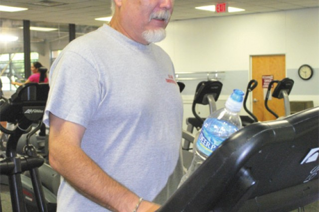 Mark Shanks, curator, Transportation Museum, completes a 30-minute workout on the treadmill at Anderson Field House. Introduction to this activity was to encourage participation and show that physically fit employees are more energetic, experience less stress and enjoy a better quality of life.