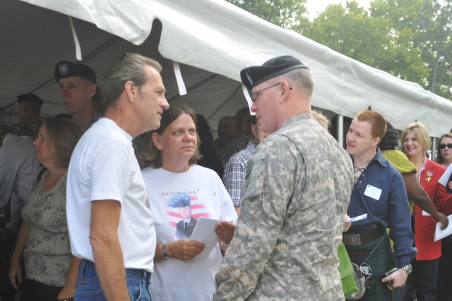 Col. Ricky Gibbs speaks with Jim and Cindy Butler, whose son, Sgt., Jacob Lee Butler, a cavalry scout from Fort Riley, died in 2003. The Butler's attended the 9-11 Commemoration and POW/MIA Remembrance Ceremony on Sept. 11 at Fort Riley to honor their son and those who have died in support of the nation.
