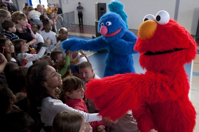 Elmo and Grover greet young fans during a performance of the Sesame Street/USO Experience for Military Families at ChiAfA..vres Air Base in Belgium Sept. 13, 2009.