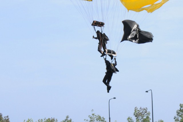 Army Golden Knights parachute onto Soldier Field during the opening ceremony of the Medal of Honor Convention in Chicago, Ill., Sept 15.