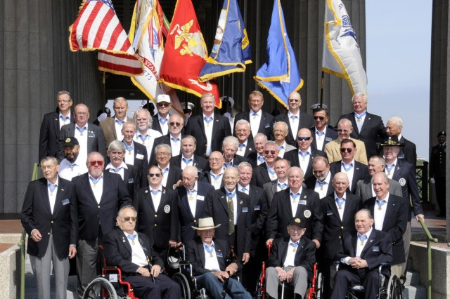 Medal of Honor recipients pose for a group photo shortly before the opening ceremony of the Medal of Honor Convention at Soldier Field, Chicago, Ill., Sept 15.