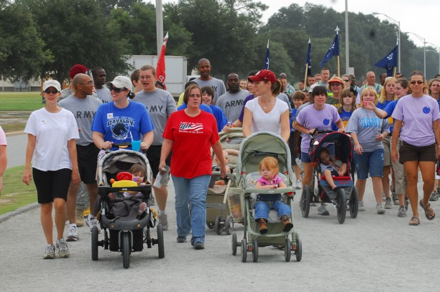 The Freedom Walk at Stewart-Watson Field, which commemorated the eighth anniversary of 9/11, drew more than 100 participants Friday.