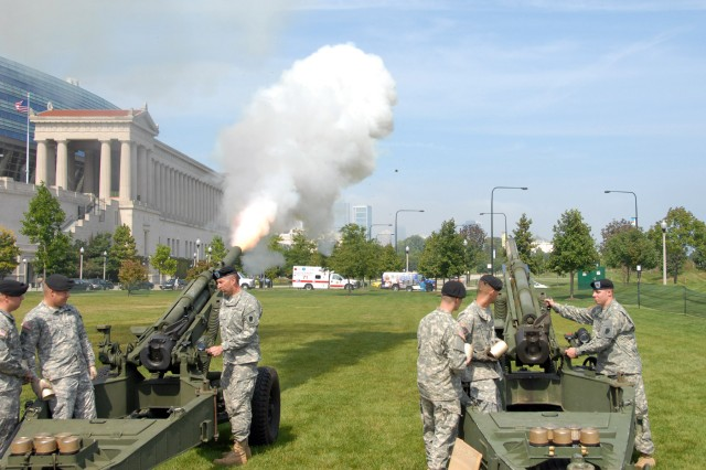 Soldiers from the Illinois National Guard, 2-123 Field Artillery, fire rounds during the opening ceremony of the Medal of Honor Convention at Soldier Field, Chicago Ill on Sept 15, 2009.