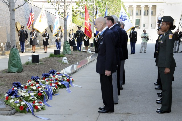 Medal of Honor Recipients, their military escorts and others gather for a wreath laying ceremony at Soldier Field in Chicago, Ill. on Sept 15, 2009.
