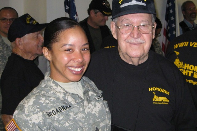 Sgt. Jajuan Broadnax meets a World War II veteran at the Huntsville International Airport for the Honor Flight on Aug. 29.