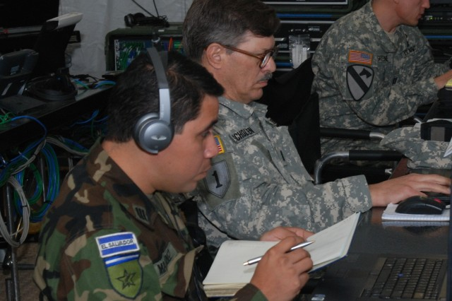 """El Salvadoran Army Capt. Julio Martinez works alongside U.S. Army South personnel at the Forward Command Post at Camp Bullis, Texas during PANAMAX 2009.  """"This is my first PANAMAX,"""" said Martinez.  """"This is a good experience for me to see new systems and perform as a supervisor officer.""""  FA PANAMAX promotes cooperation and interoperability essential to overcoming hemispheric challenges.  FA PANAMAX is specifically focused on the security of the Panama Canal and Central America.   (Arwen Consaul, U.S. Army South Public Affairs/Photo released)"""""""