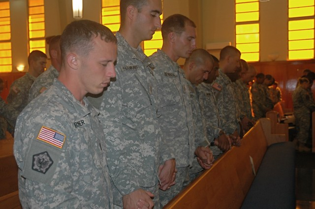 "SCHOFIELD BARRACKS, Hawaii - Soldiers observe a moment of silence at the conclusion of the service, ""Honoring Our Heroes: Remembering Our Fallen of 9/11,"" Sept. 11, at the Main Post Chapel, here."