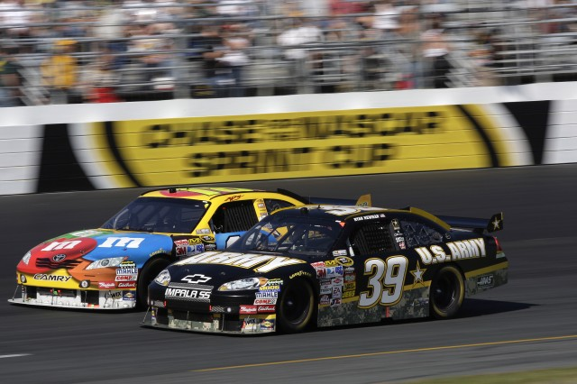 Ryan Newman edges his Number 39 Army Chevrolet Impala past Kyle Busch during Sunday's Sylvania 300 at New Hampshire Motor Speedway. Newman finished seventh overall.