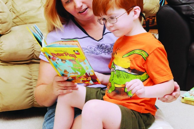 """Kelli Reynoldson and her son, Alex, 5, read together at their Level Plains home Monday. Alex has faced developmental delays since age 3 and is enrolled in the Exceptional Family Member Program (EFMP) here. Fort Rucker EFMP staff will hold an education workshop here next week to assist Families with special needs children. """""""