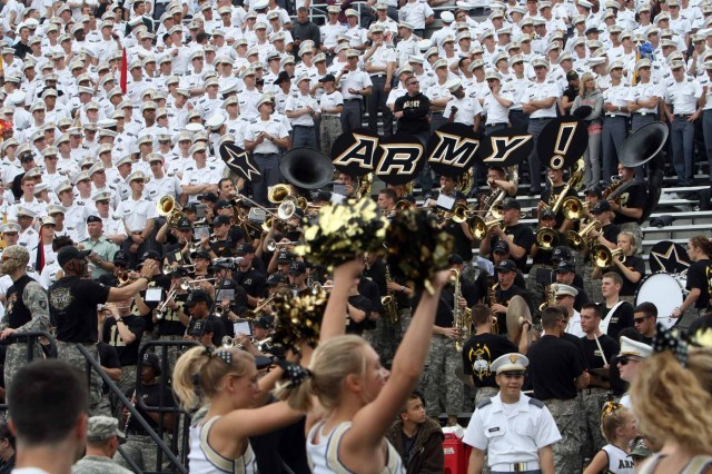 Cadets get in on the game day action at Michie Stadium. The academy requires all students to attend football games or show their school spirit through cheer squad, cadet band or other cadet-led groups.