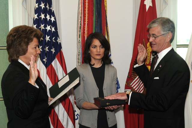 John McHugh is sworn-in as the 21st secretary of the Army during a Pentagon ceremony, Sept. 21, 2009.  Joyce Morrow, administrative assistant to the secretary of the Army, administers the oath of office as Anne LeMay, special assistant to the secretary of the Army, holds the Bible.