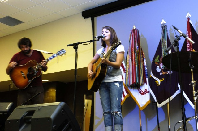 "Singer Bethany Dillon performs a song from her new album Aca,!A""Stop and ListenAca,!A? during Patriot Day ceremonies at Fort Gillem Sept. 11. Dillon also held a concert for Fort Dillem personnel following the ceremony."