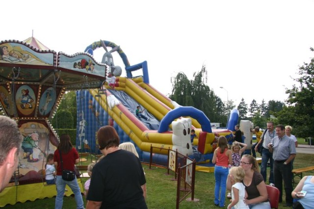 Children enjoyed many rides, games and activities at USAG SchinnenAca,!a,,cs 40th Anniversary Celebration Sept 19. Here, the merry-go-round swings and slide are kept busy.