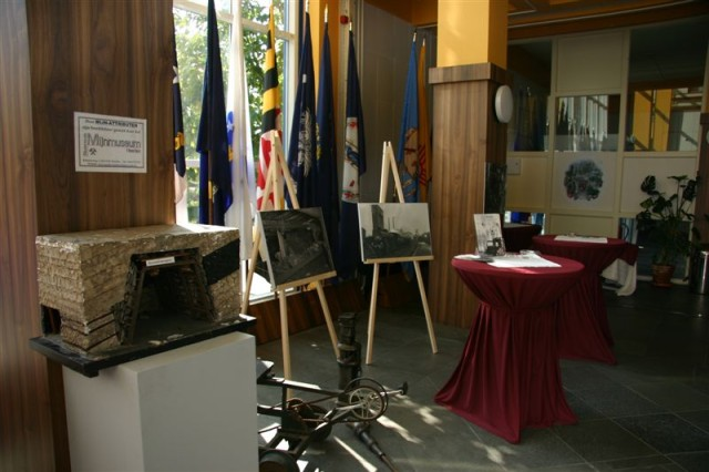 With artifacts from the National Mining Museum in Heerlen, Netherlands, USAG Schinnen transformed the headquarters building foyer into a gallery depicting the mining past of the community and how Shaft IV became the site of USAG Schinnen today.